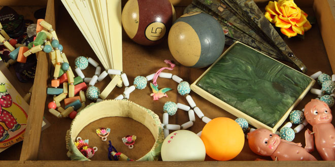 Celluloid's past: billiard balls, jewelry, cigarette case, greeting cards, toys, and Ping Pong balls