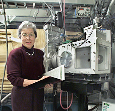 Darleane Hoffman with the instruments she uses to track down heavy elements. Photo courtesy Ernest Orlando Lawrence Berkeley National Laboratory.