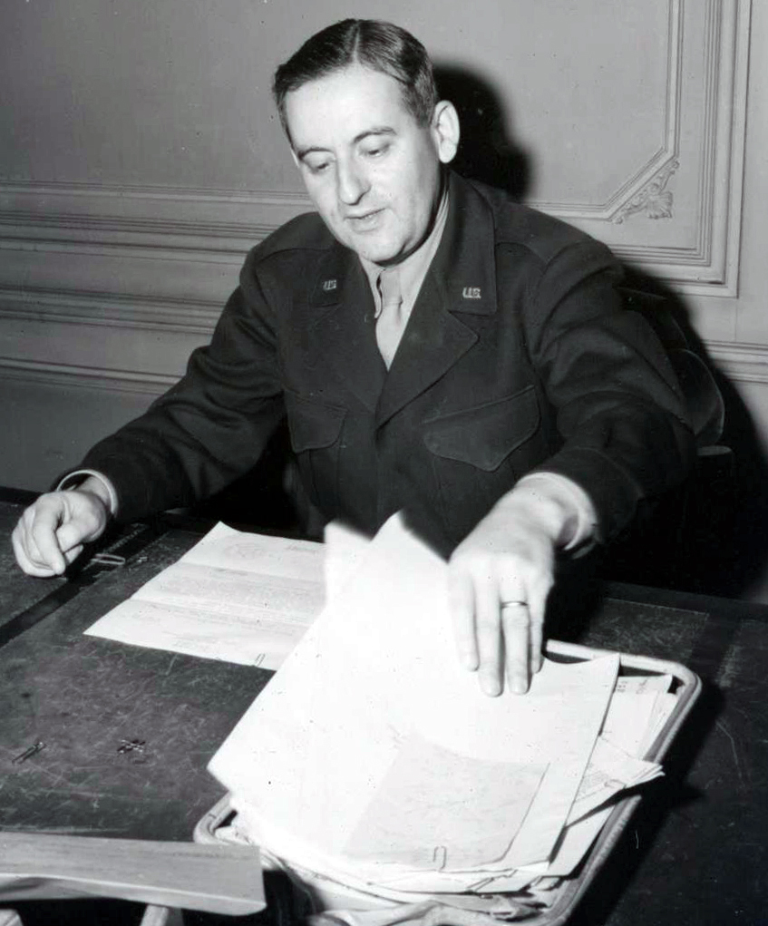 Man in uniform seated at desk