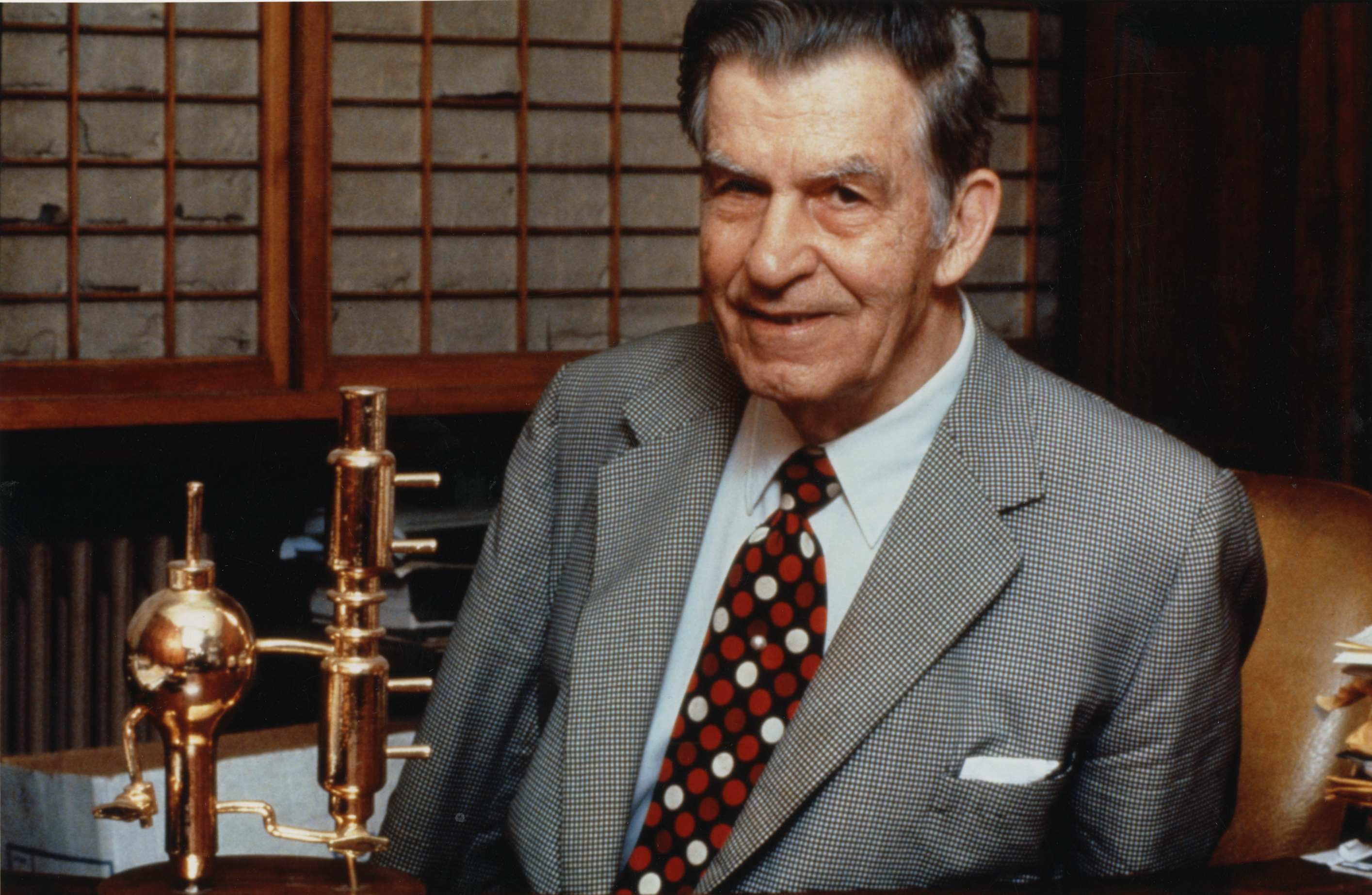 Donald Othmer, with a gold-plated Othmer still in the background.