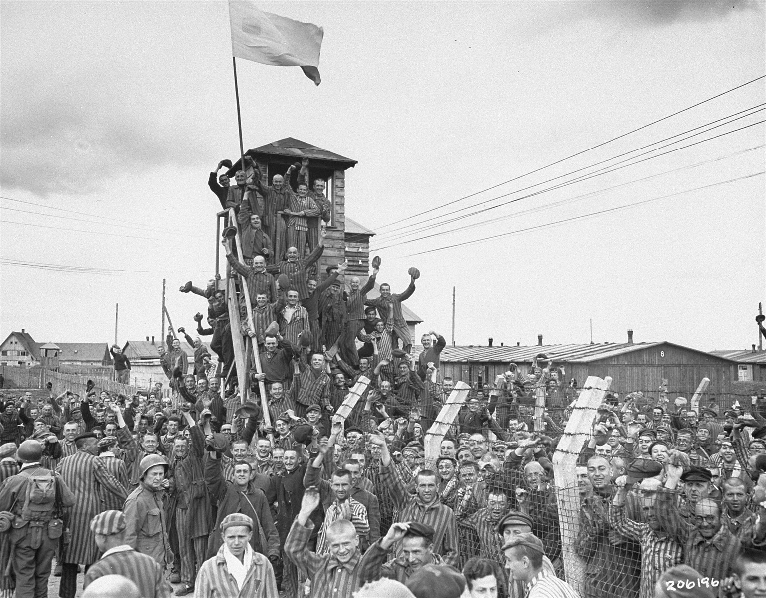 Photo of concentration camp survivors cheering