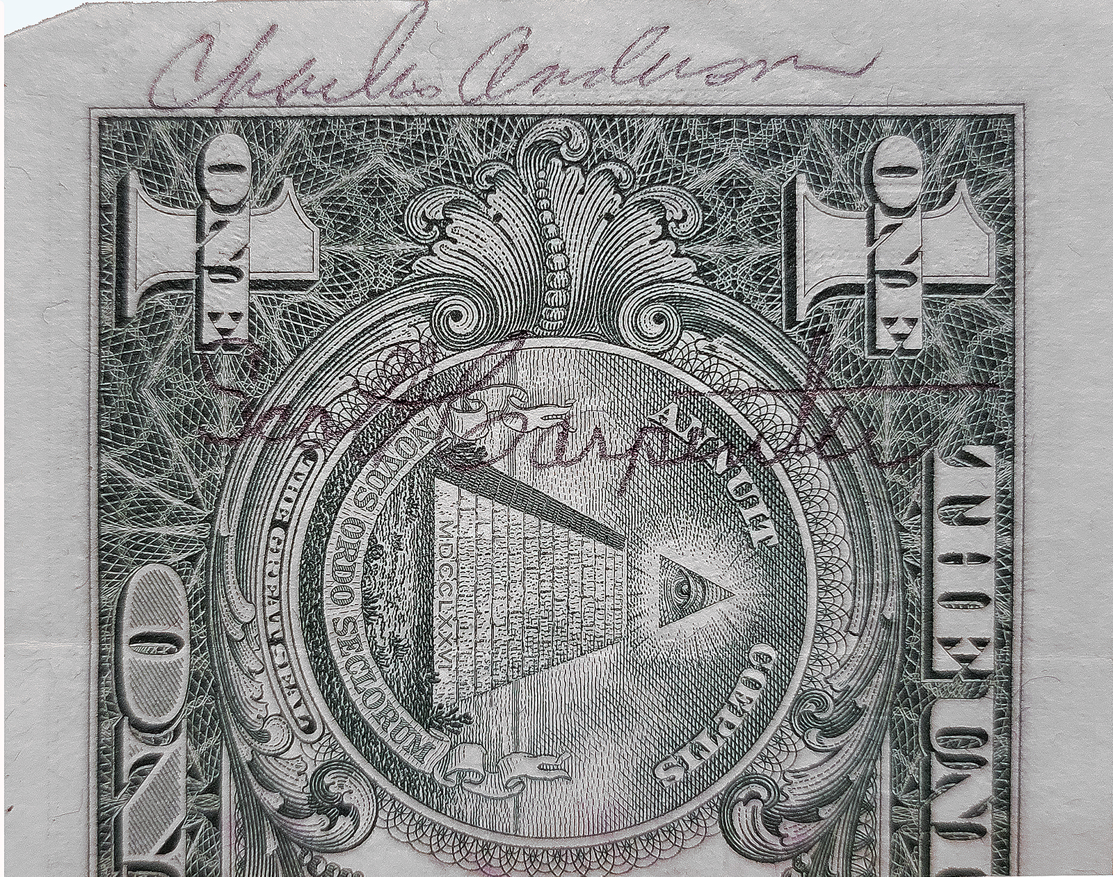 Photo of dollar bill with signatures