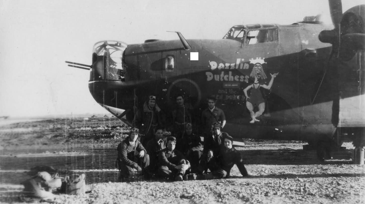 Black and white photo of air force bomber and crew