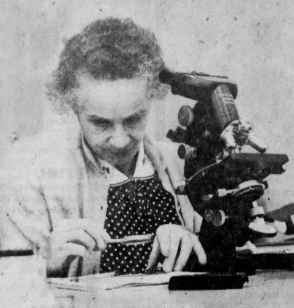 Newspaper photo of woman with microscope