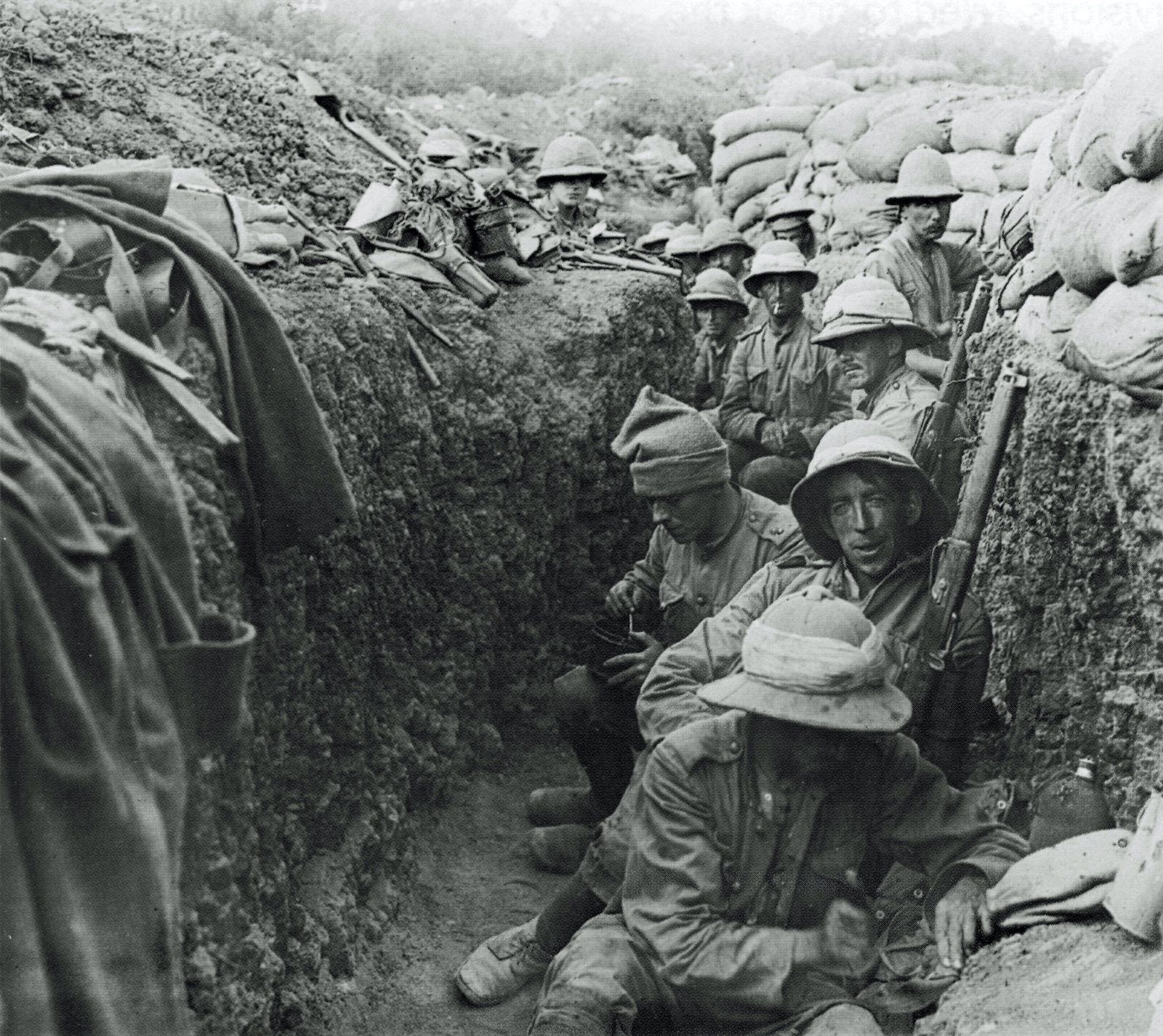 black and white photo of a group of soldiers standing and sitting