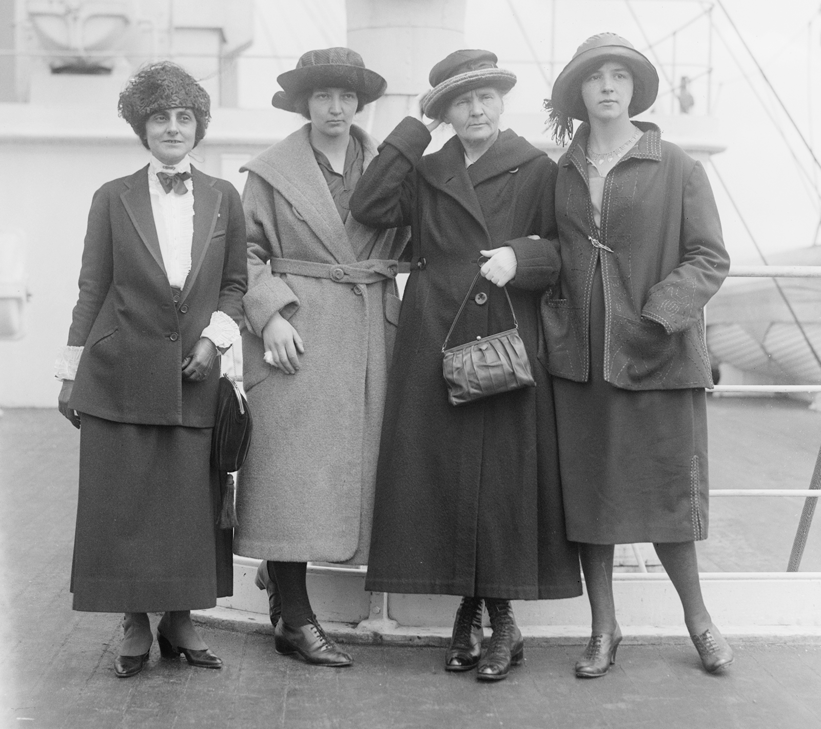 Meloney and Curies posing on the deck of a ship