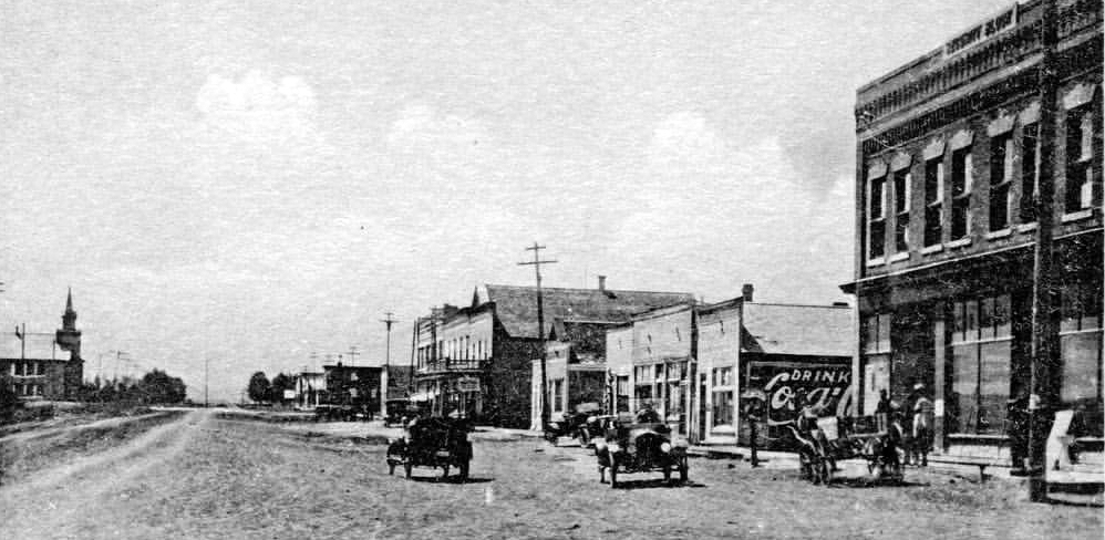 old black and white photo of small downtown