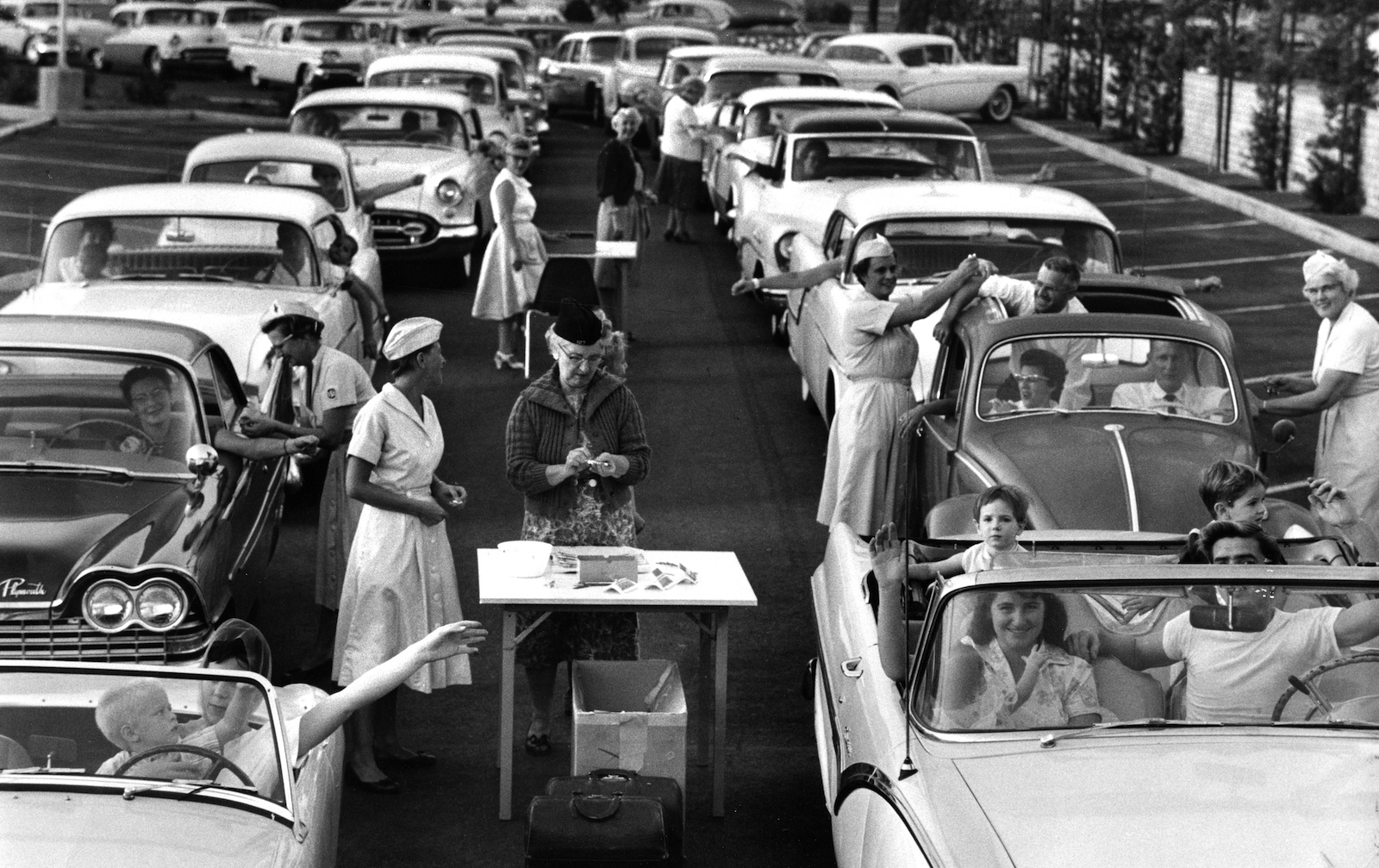 Cars lined up with nurses working