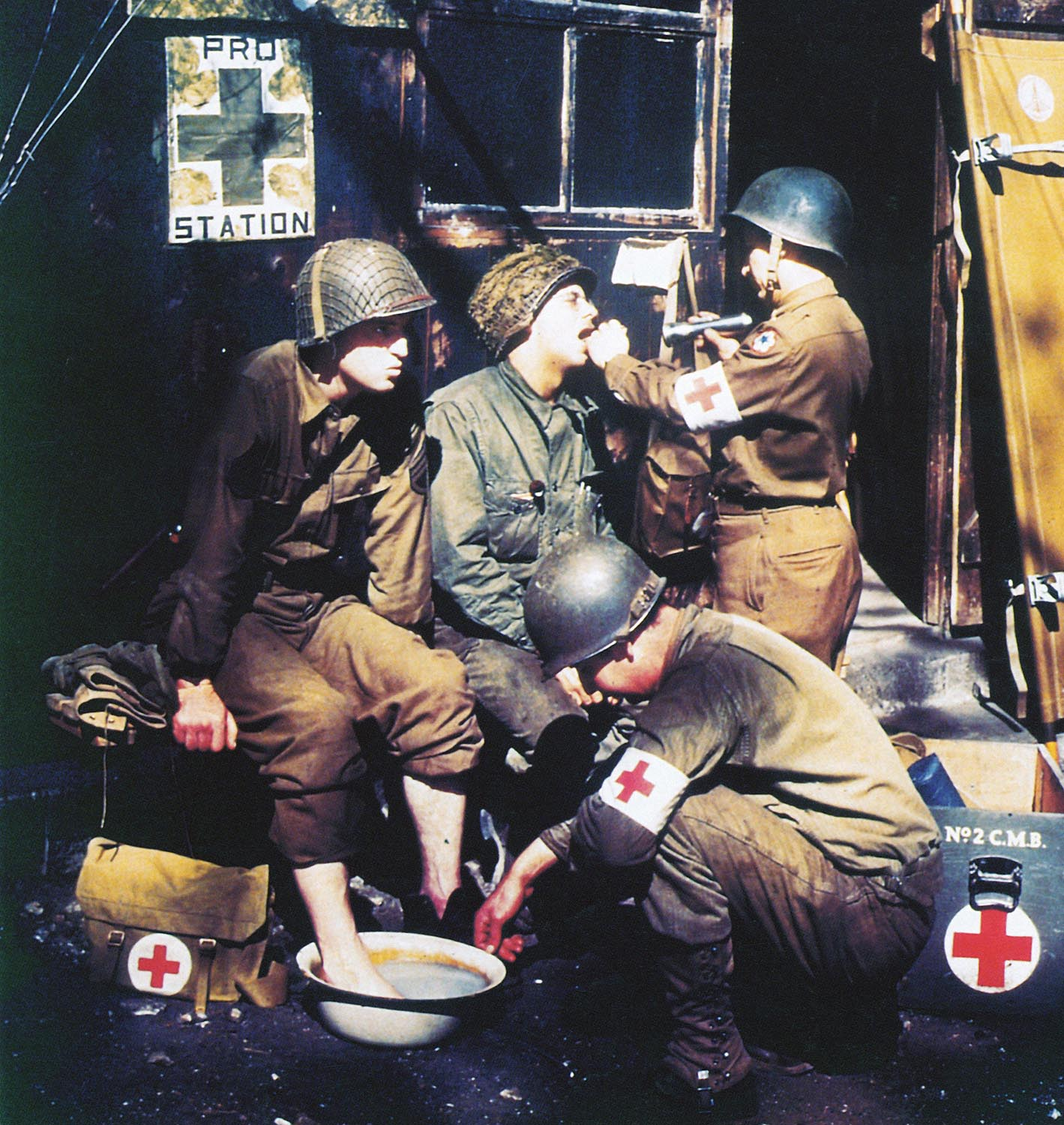 U.S. Army medics treating soldiers in England before the invasion of Normandy, 1944.
