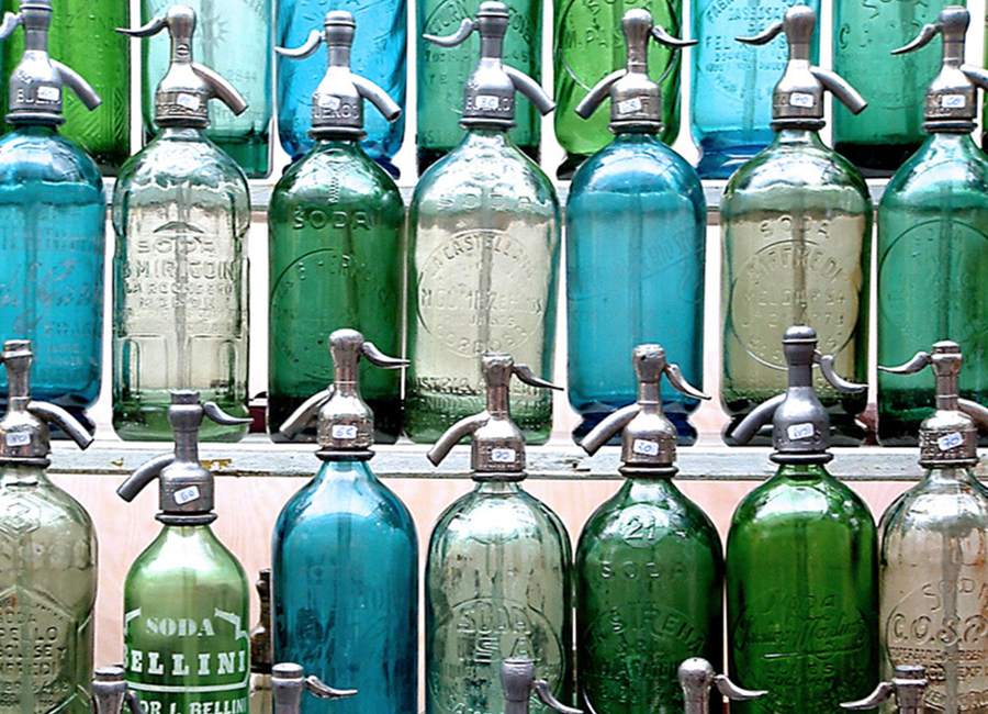 Old soda spray bottles in various colors