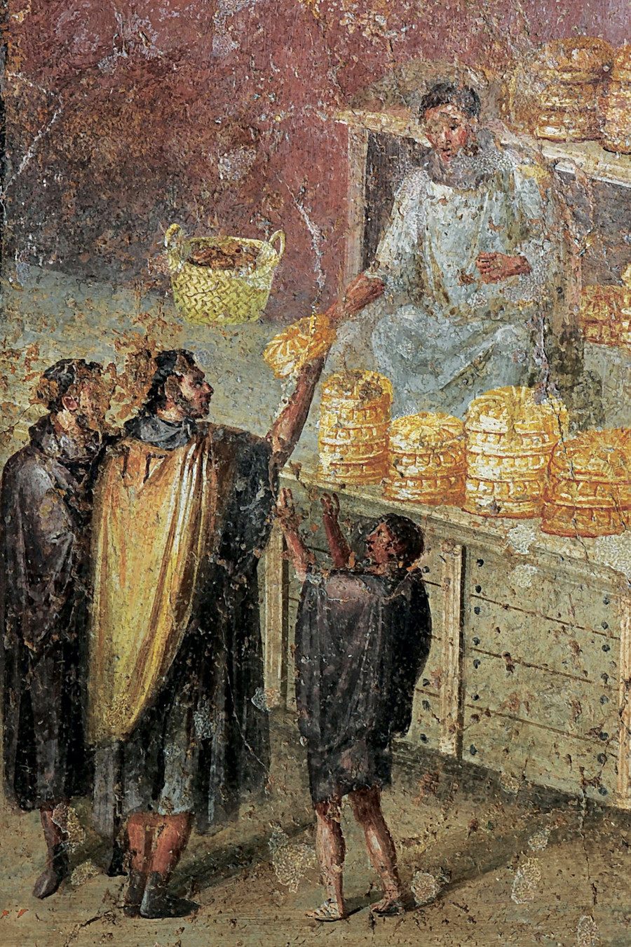 Color fresco showing man passing bread to another man