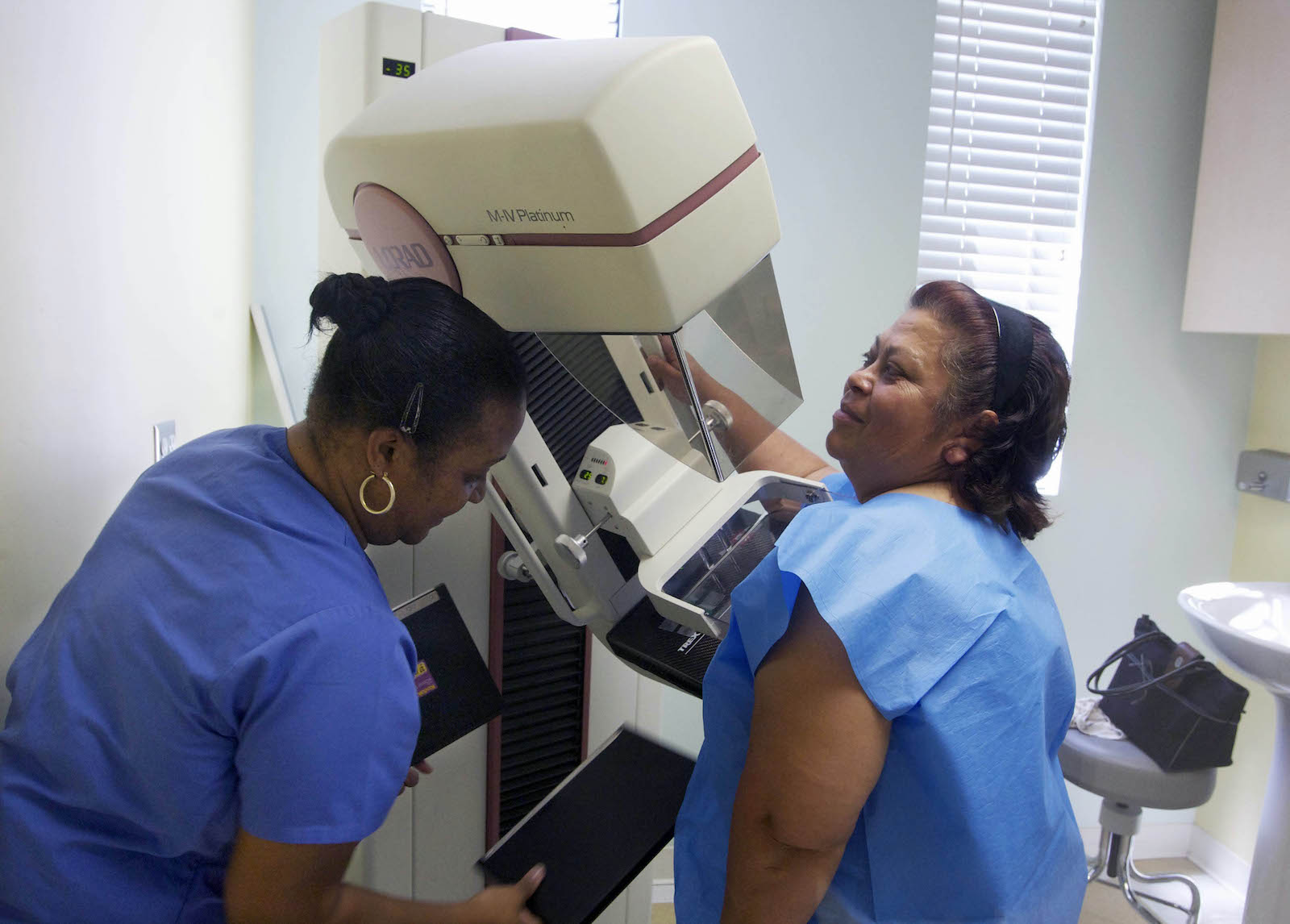 Clinical scene of a mammogram being given