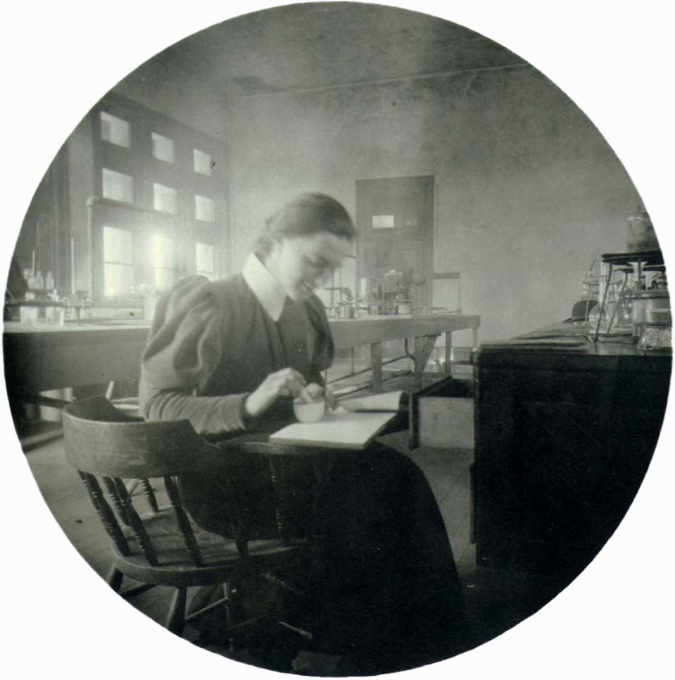Circular photo of young woman in lab