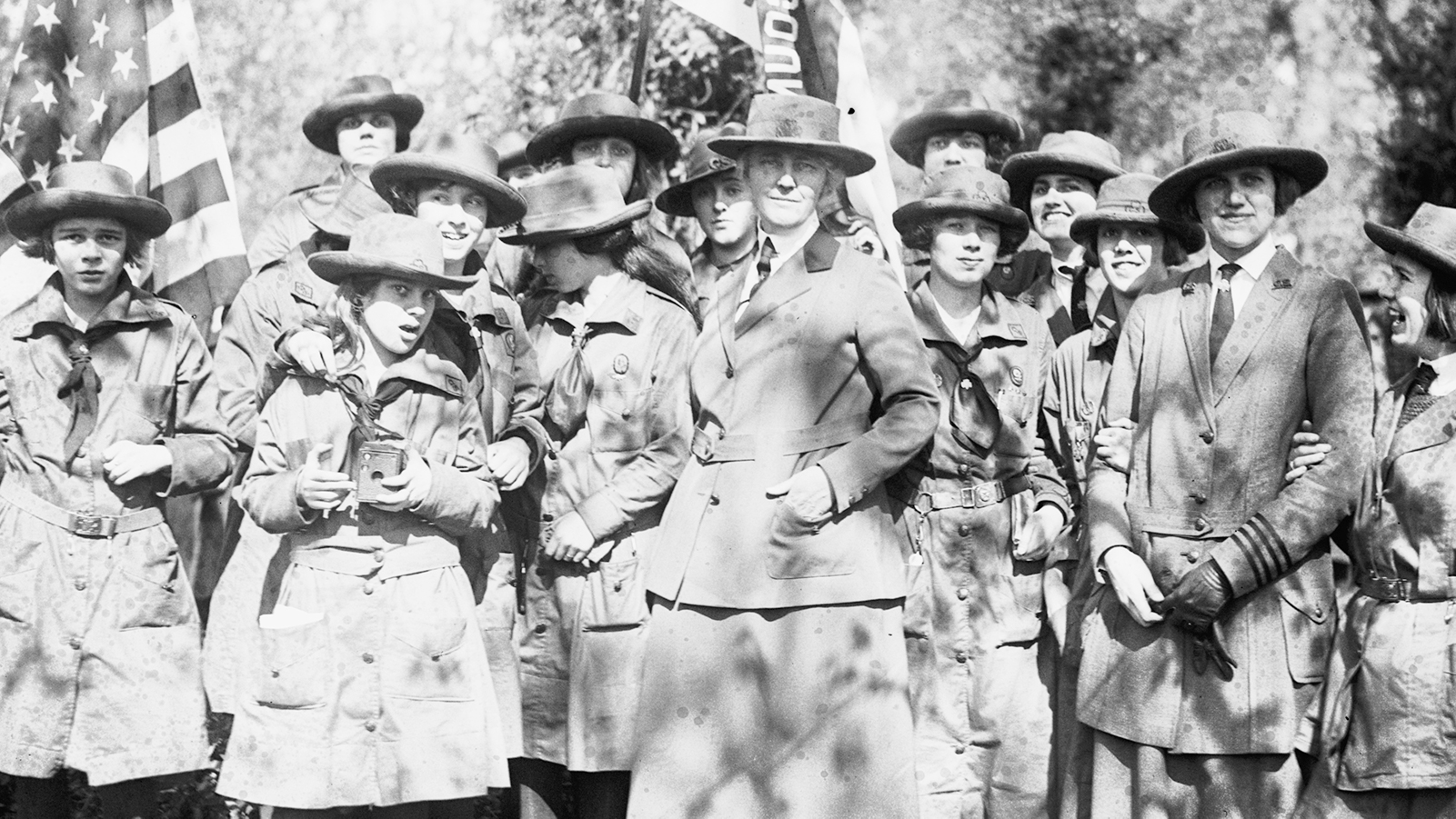 Photo of women and girls in uniform in the woods