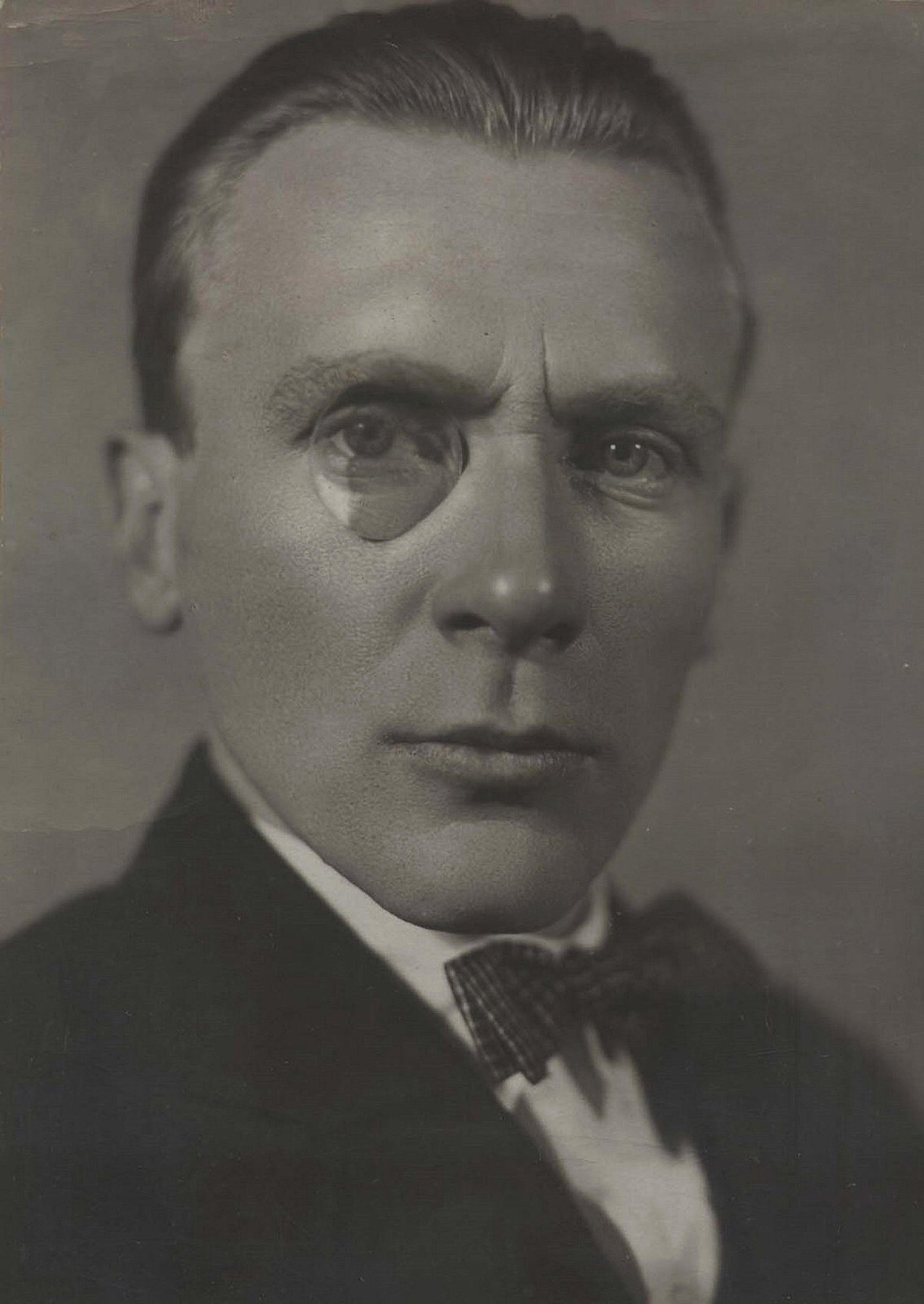 Portrait of Bulgakov with monocle and slicked hair