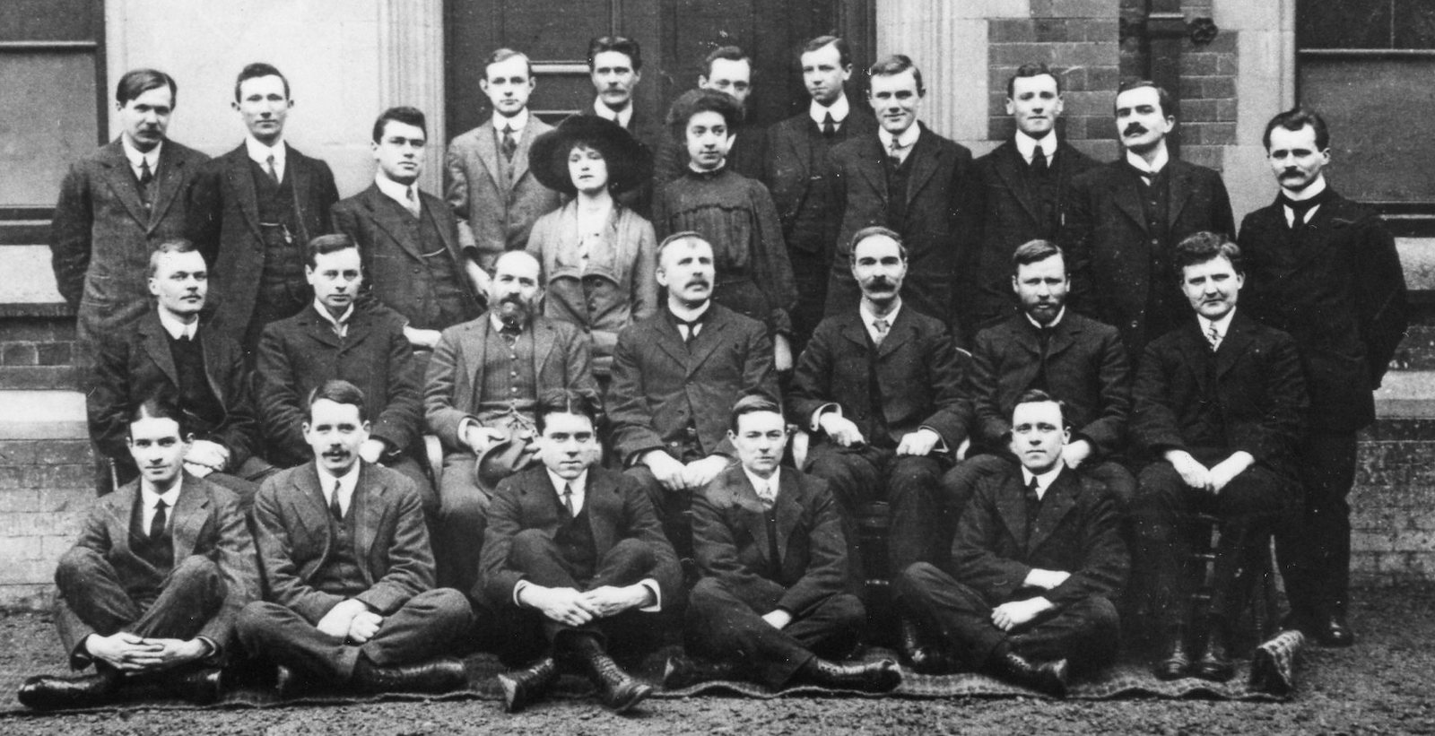 black and white photo of group of men and women