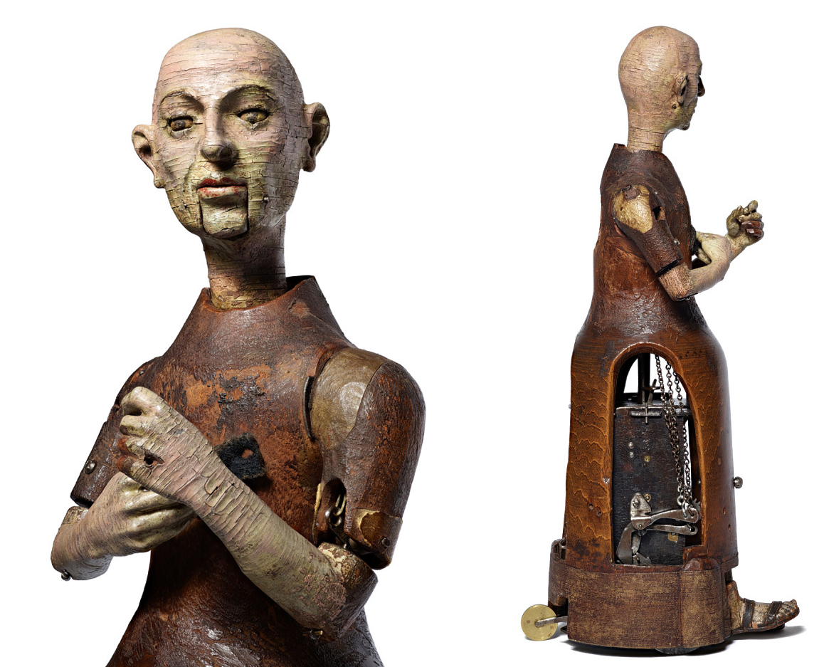 Wooden painted human figure with mechanical workings