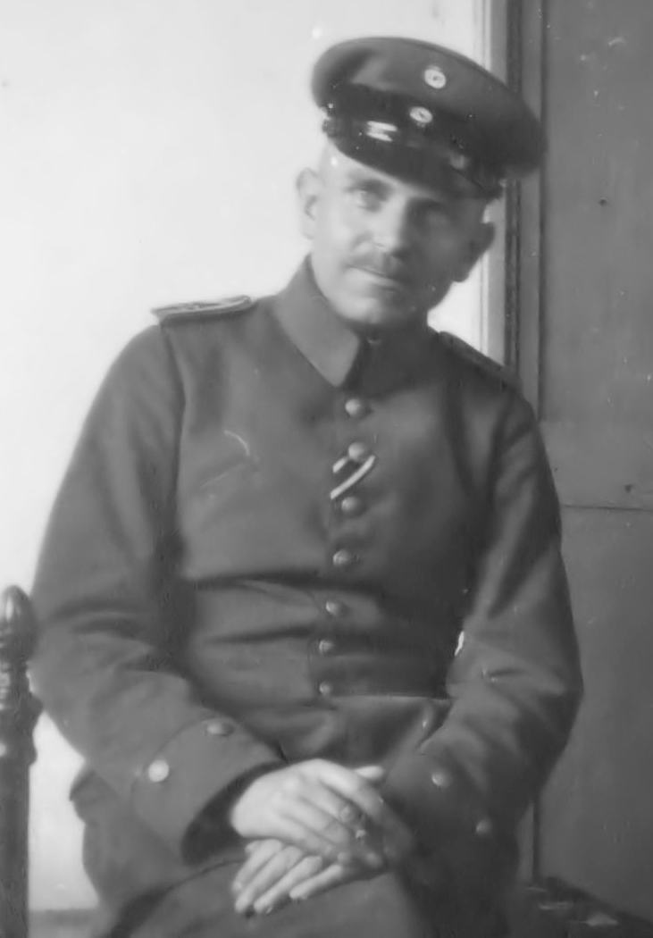 Black and white photo portrait of man in uniform