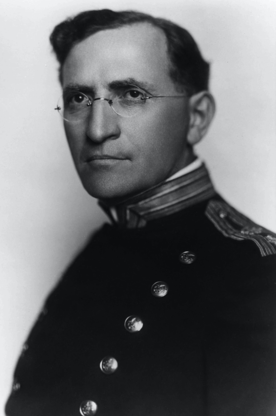 Portrait of a man in uniform and glasses