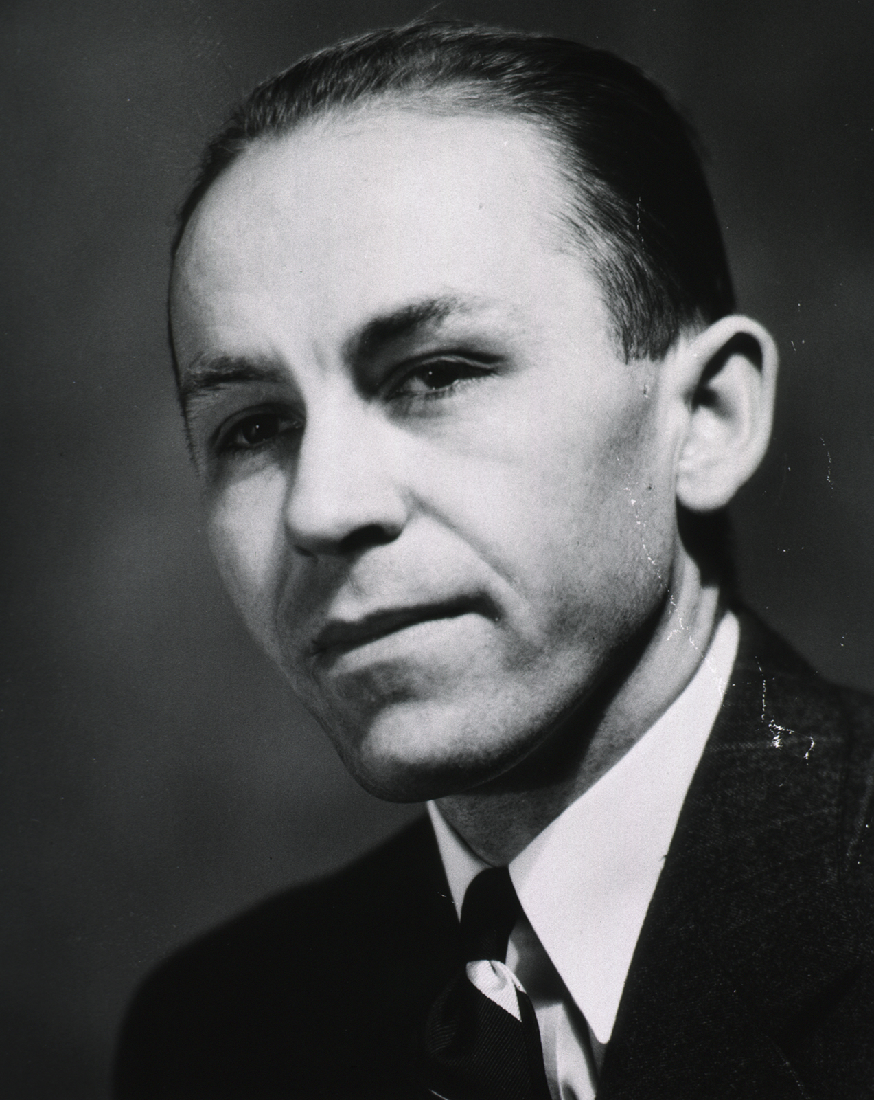 Black and white photo of man in suit