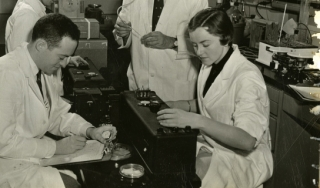 Herman Kalckar with laboratory assistants.