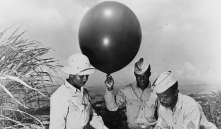 Soldiers during World War II gathering meteorological data in the Caribbean.