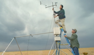 Climate scientists set up CO2-monitoring equipment.