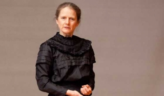 Susan Marie Frontczak in character as Marie Curie