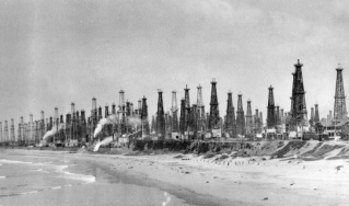 Oil derricks line Huntington Beach, California, in this 1956 photo.