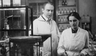 Black and white photo of man and woman in a lab