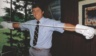 Man pulling on a white tube of polymer