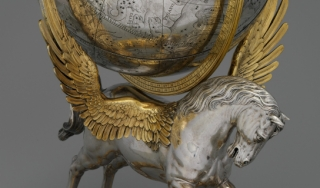 Silver astronomical globe set on a statue of a winged horse