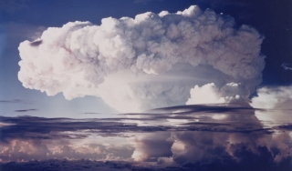 Color photograph of a mushroom cloud