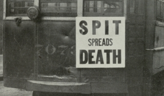 "Photo from 1918 showing Philadelphia streetcar with sign reading ""Spit spreads death"""