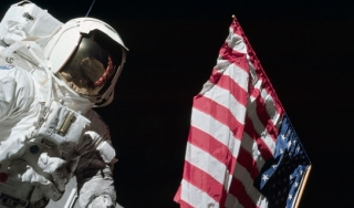 Apollo 17 astronaut Eugene Cernan on moon with American flag