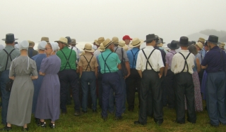 A group of Amish people standing in a field