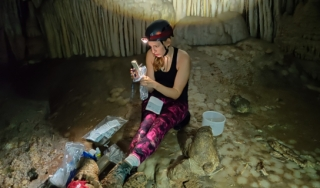 Gabriela Serrato Marks doing fieldwork in a cave.
