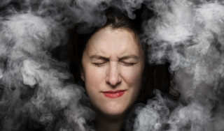 Photo illustration of woman with migraine