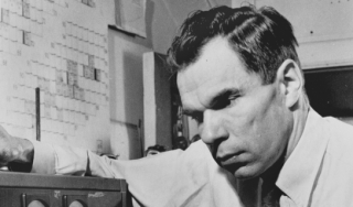 Glenn T. Seaborg in 1942, adjusting a Geiger counter.