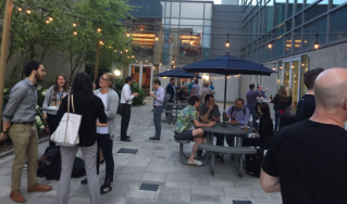 A casual conference reception in the courtyard