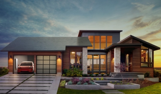 Suburban house with electric car in driveway