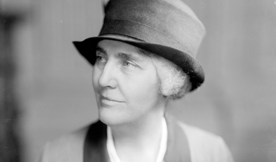 Black and white photo portrait of woman in uniform