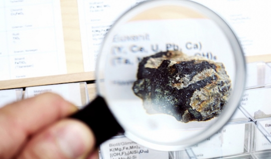 Magnifying glass over rare earth element