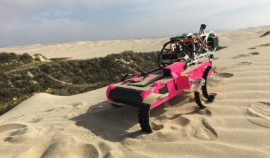 RHex marches up a dune in Pismo Beach, California, carrying a mechanical sensor that scrapes the dune's surface to detect how much force is needed for the wind to pick up grains of sand.