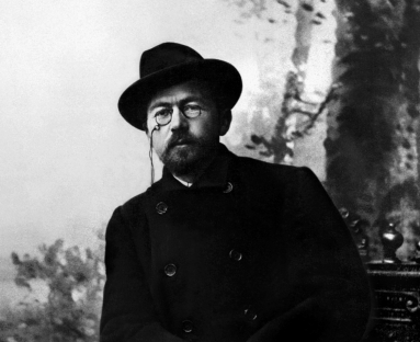 Photo of Anton Chekhov with glasses and hat
