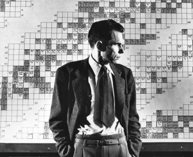 Man in profile in front of wall chart