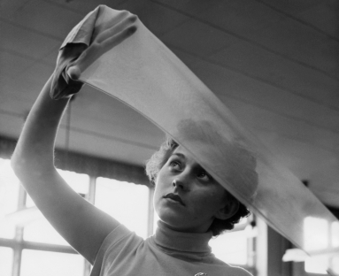 Swedish worker inspects nylon stocking, 1954