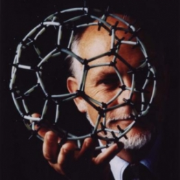 Richard Smalley with a model of a buckyball.