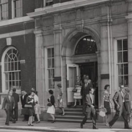 Employees exiting Rohm and Haas home office building 1965