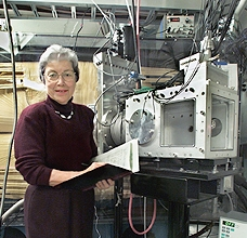 Darleane Hoffman with the instruments she uses to track down heavy elements.